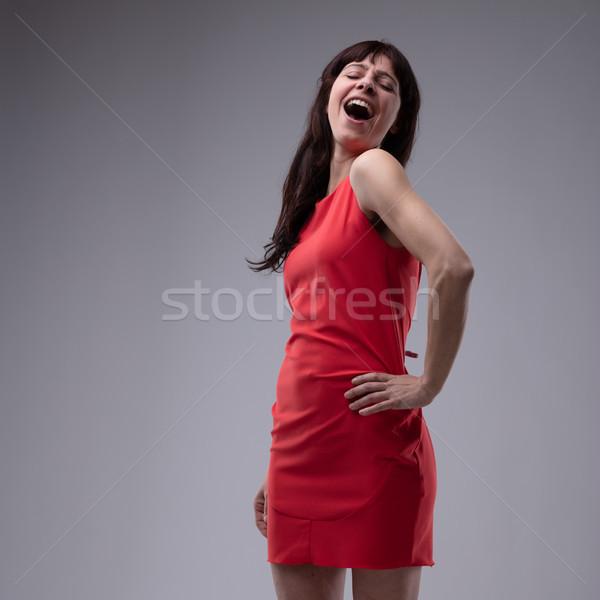 Gelukkig vrouw rode jurk permanente zingen hand Stockfoto © Giulio_Fornasar