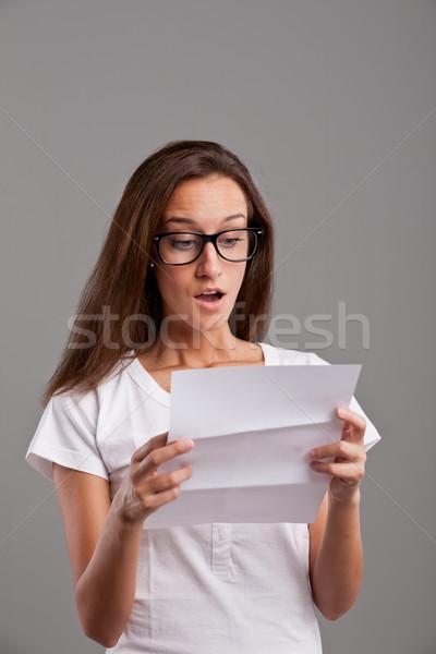 girl reading astonishing news on white letter Stock photo © Giulio_Fornasar