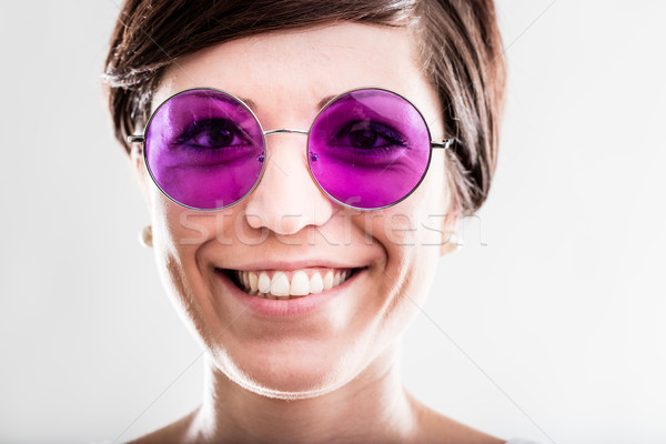 Happy attractive woman in trendy sunglasses Stock photo © Giulio_Fornasar