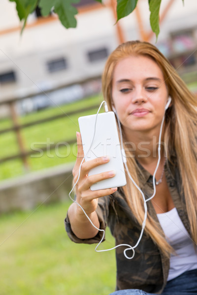 girl making a self portrait with a mobile phone Stock photo © Giulio_Fornasar