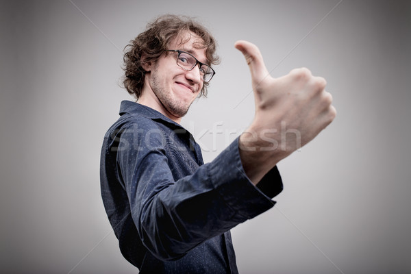successful man portrait with a thumb up Stock photo © Giulio_Fornasar