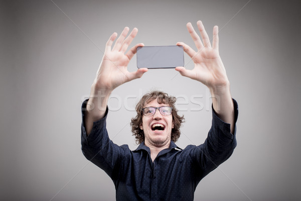 very happy man making a selfie Stock photo © Giulio_Fornasar