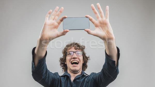 Boldog férfi készít örömteli szemüveg önarckép Stock fotó © Giulio_Fornasar