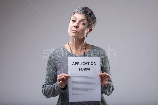 Expectant woman holding up an application form Stock photo © Giulio_Fornasar