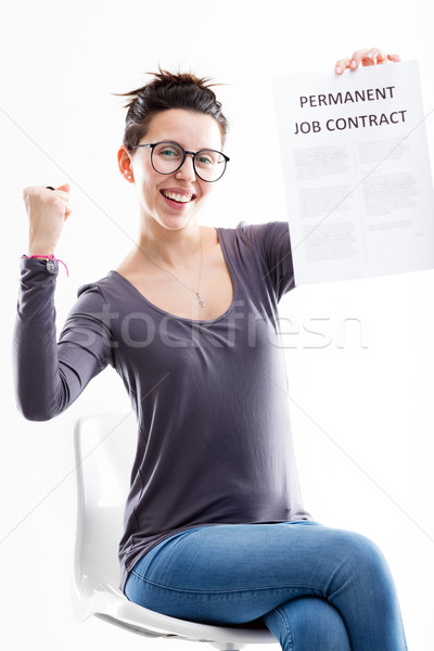 exulting woman holding her job contract Stock photo © Giulio_Fornasar