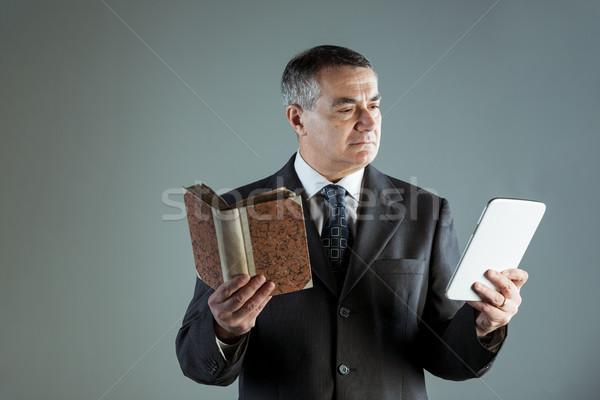 Senior man reading text from a modern tablet PC Stock photo © Giulio_Fornasar