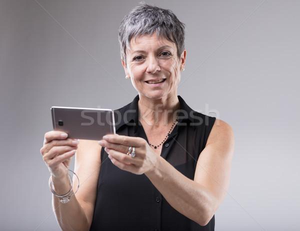 Mayor mujer teléfono móvil horizontal posición Foto stock © Giulio_Fornasar
