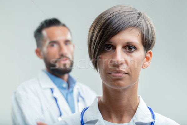 Serious female doctor or nurse in a medical team Stock photo © Giulio_Fornasar