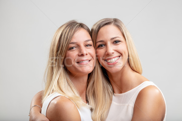 Two young blond women in a close embrace Stock photo © Giulio_Fornasar