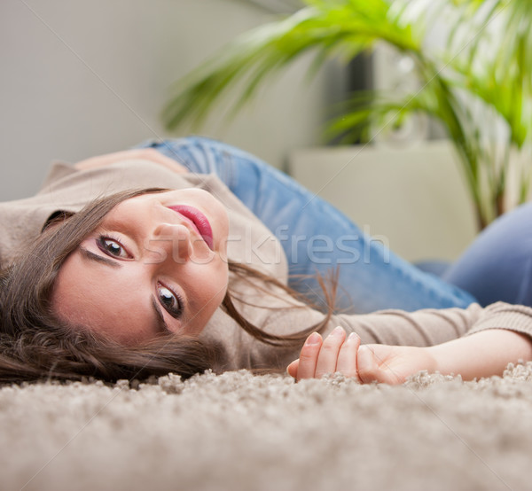 young beautiful woman smiling upside-down on the floor Stock photo © Giulio_Fornasar