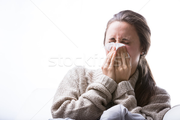 woman blowing her nose because of a cold Stock photo © Giulio_Fornasar