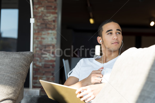 handsome guy using a tablet and listening music Stock photo © Giulio_Fornasar