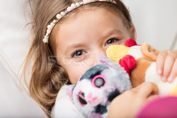 Cute smiling little girl cuddling her toys Stock photo © Giulio_Fornasar