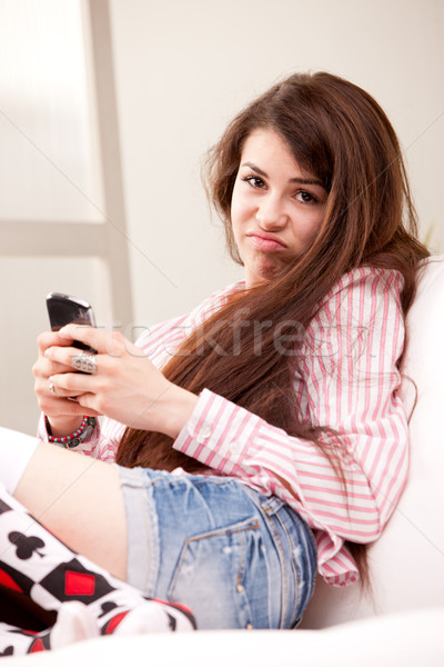 girl holding a grouch against mobile phone Stock photo © Giulio_Fornasar