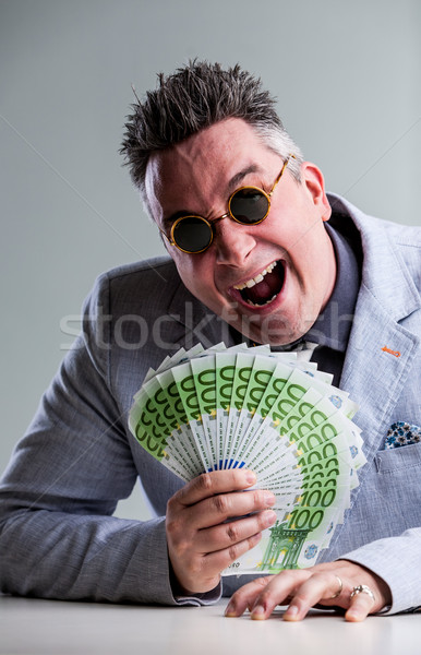 Stok fotoğraf: çılgın · para · güneş · gözlüğü · açgözlü · takım · elbise · ceket