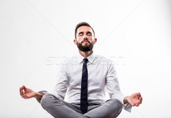 Nyugodt üzletember meditáció póz fehér üzletember Stock fotó © Giulio_Fornasar