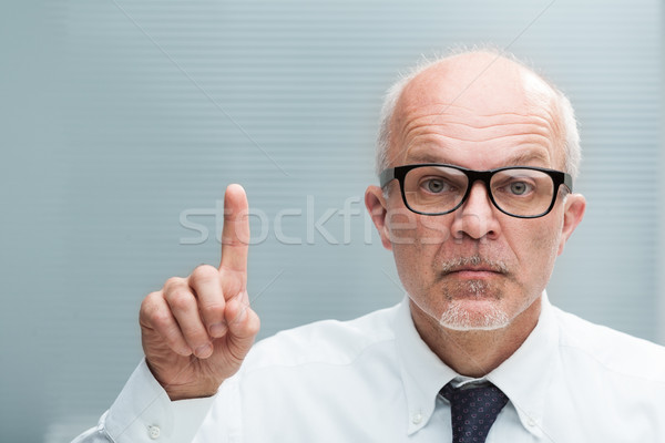 man rising an index finger taking exception Stock photo © Giulio_Fornasar