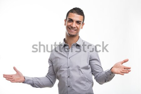 Young cheerful man with open arms gesture Stock photo © Giulio_Fornasar