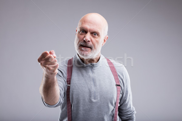 aged angry man threatin with a punch Stock photo © Giulio_Fornasar