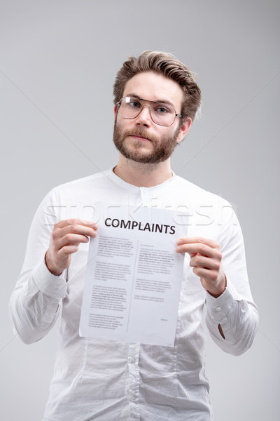 Angry resolute man holding a list of Complaints Stock photo © Giulio_Fornasar