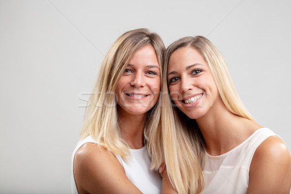 Two happy smiling women with long blond hair Stock photo © Giulio_Fornasar
