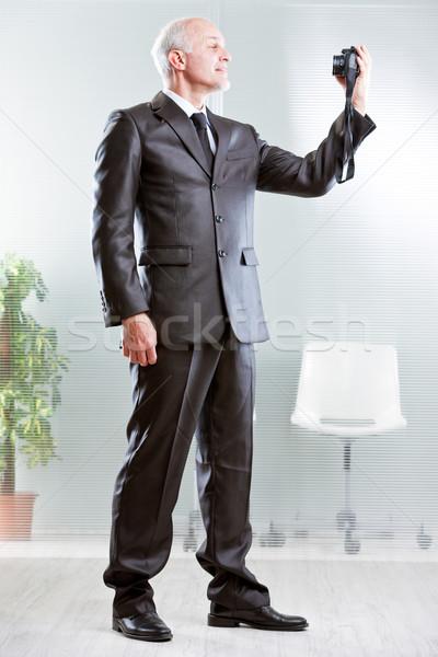 Forte piedi imprenditore fotocamera digitale business Foto d'archivio © Giulio_Fornasar