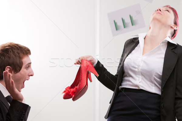 business man receiving lovely red high heels shoes Stock photo © Giulio_Fornasar