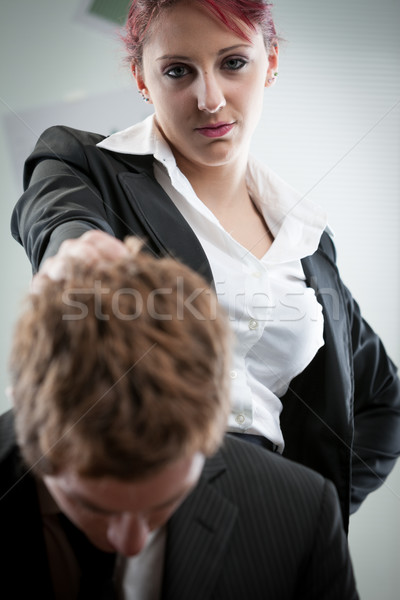woman humiliating a man on the workplace Stock photo © Giulio_Fornasar