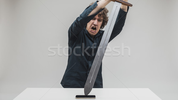 angry man hitting his phone with a sword Stock photo © Giulio_Fornasar