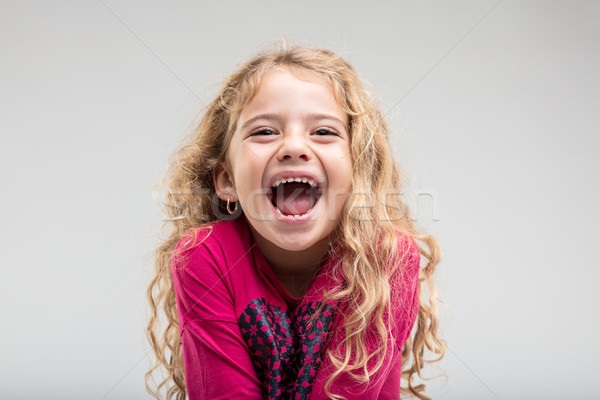 Laughing schoolgirl with curly hair Stock photo © Giulio_Fornasar