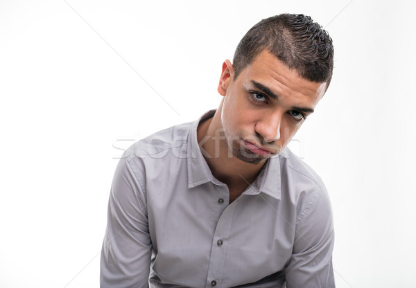 Młodych rozczarowany człowiek biały portret odizolowany Zdjęcia stock © Giulio_Fornasar