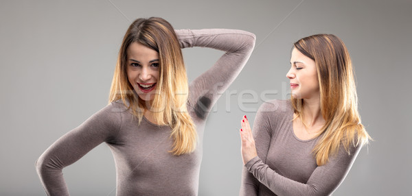 woman disgusted by body odor Stock photo © Giulio_Fornasar