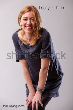 Stock photo: real woman smiling and standing still