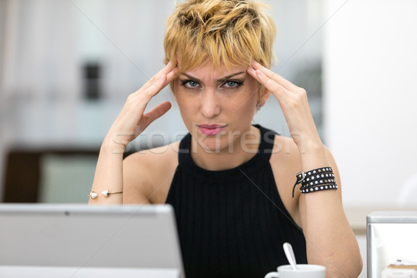working overtime a woman has a headache Stock photo © Giulio_Fornasar