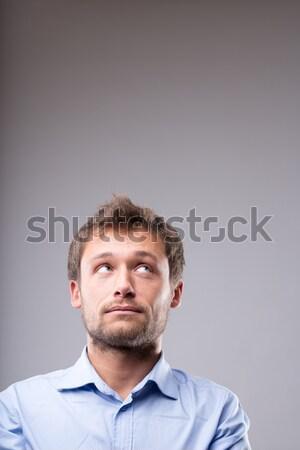 Young man with a contemplative expression Stock photo © Giulio_Fornasar