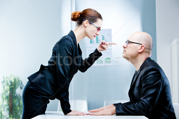 Stock photo: woman reproaching man at work