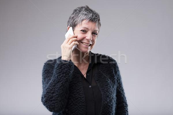 улыбаясь женщину мобильных привлекательный старший Сток-фото © Giulio_Fornasar