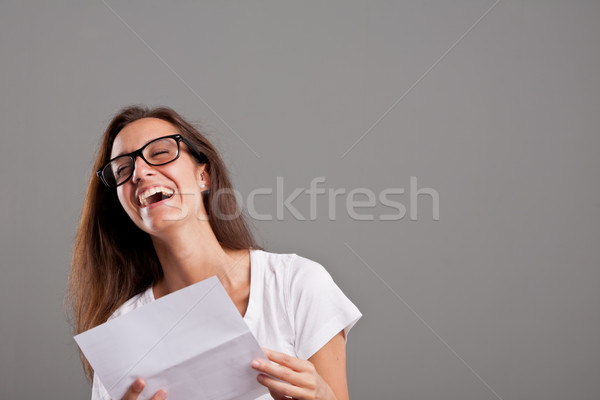 girl laughing about something she read Stock photo © Giulio_Fornasar