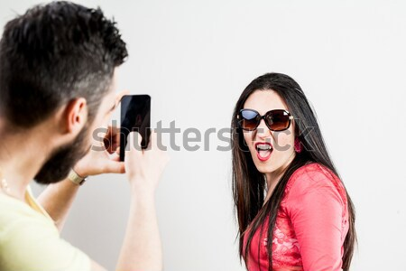 woman disappointed about his man on his mobile Stock photo © Giulio_Fornasar