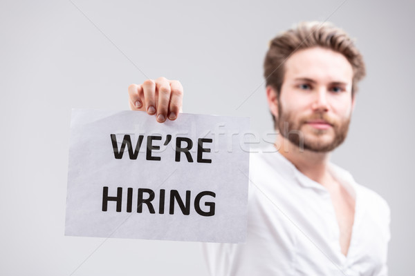 Bearded man holding up a We're Hiring sign Stock photo © Giulio_Fornasar