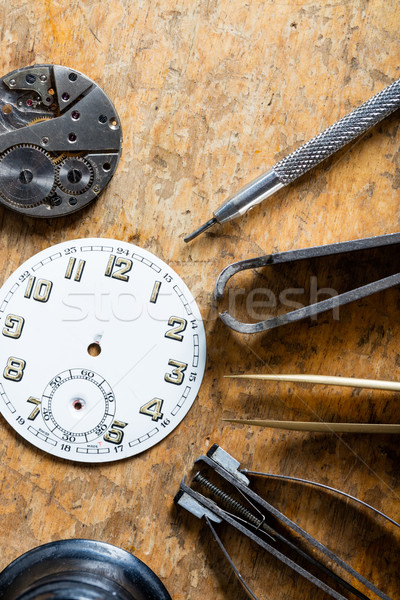 Various horologists tools with a clock dial Stock photo © Giulio_Fornasar