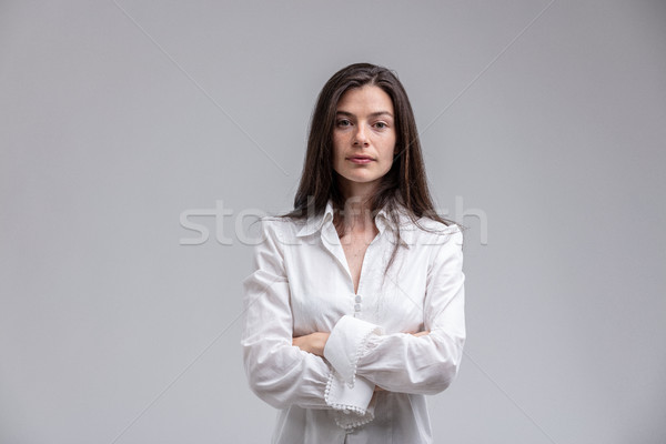 Long-haired woman standing with arms crossed Stock photo © Giulio_Fornasar