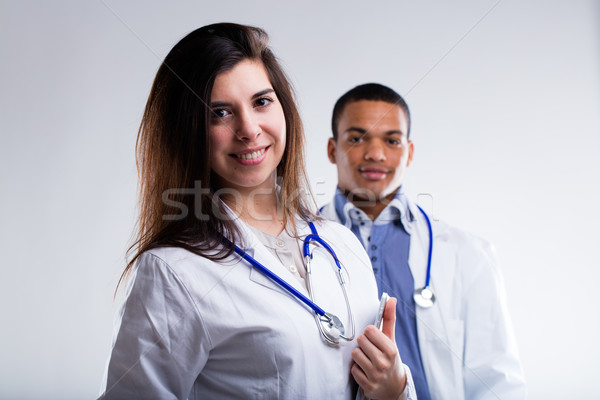 doctors with welcoming smiles waiting for you Stock photo © Giulio_Fornasar