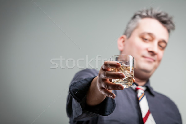 man offering some liquid courage Stock photo © Giulio_Fornasar