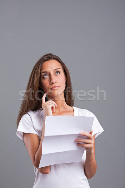 woman worried or thinking about the letter Stock photo © Giulio_Fornasar