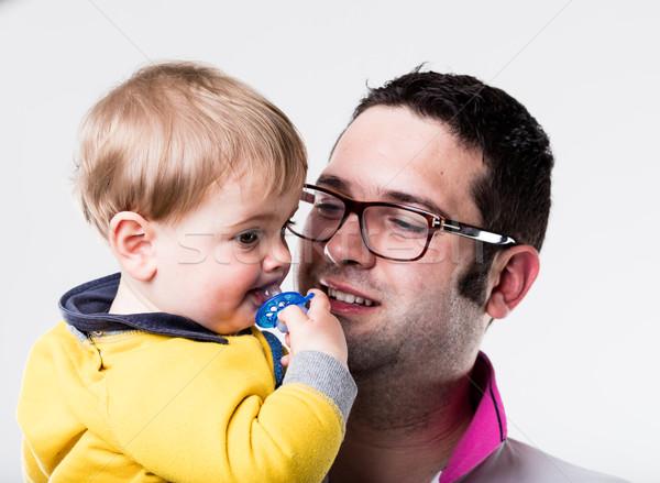 Baba bakıyor oğul emzik küçük aile Stok fotoğraf © Giulio_Fornasar
