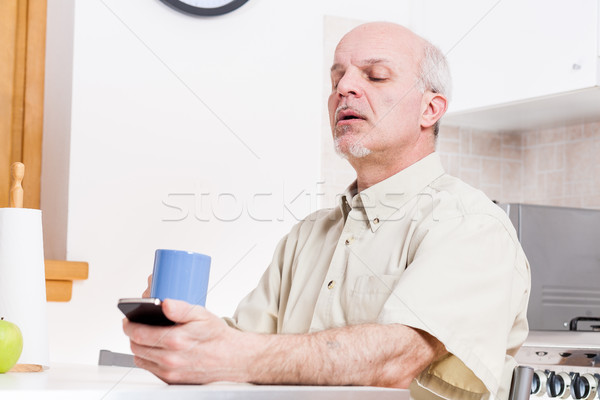 mature man has problems with his eyesight Stock photo © Giulio_Fornasar