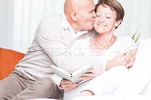 Affectionate man kissing his wife on the cheek Stock photo © Giulio_Fornasar