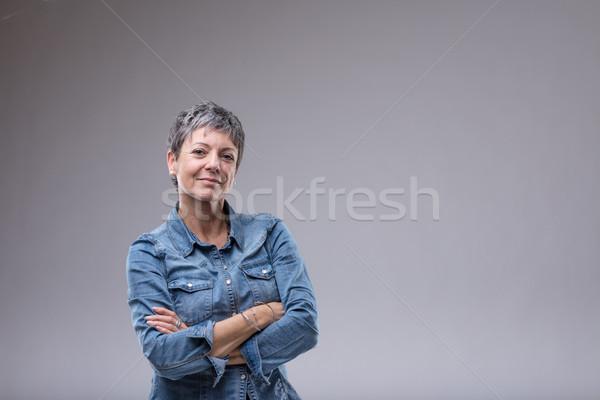 Confident senior woman with folded arms Stock photo © Giulio_Fornasar