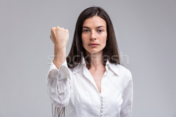 focus on the FIST of a stern woman Stock photo © Giulio_Fornasar